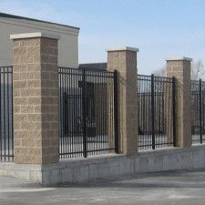 Ornamental metal with stone pilars